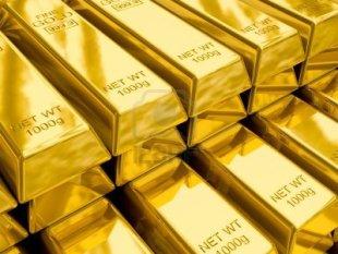 12635676-stacks-of-gold-bars-close-up